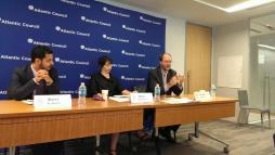 Professor Paul Williams participates in a panel discussion at the Atlantic Council, using a Rubik's Cube to describe the Yemen peace negotiations.