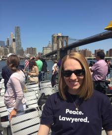 Jessica sports her Lawyering Peace T-Shit over the summer.