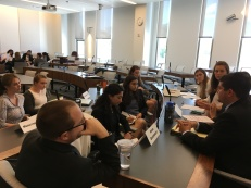 The Assad team worked together during the negotiation simulation.