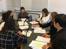 Research Associates's practice their negotiation skills during a Yemen simulation.